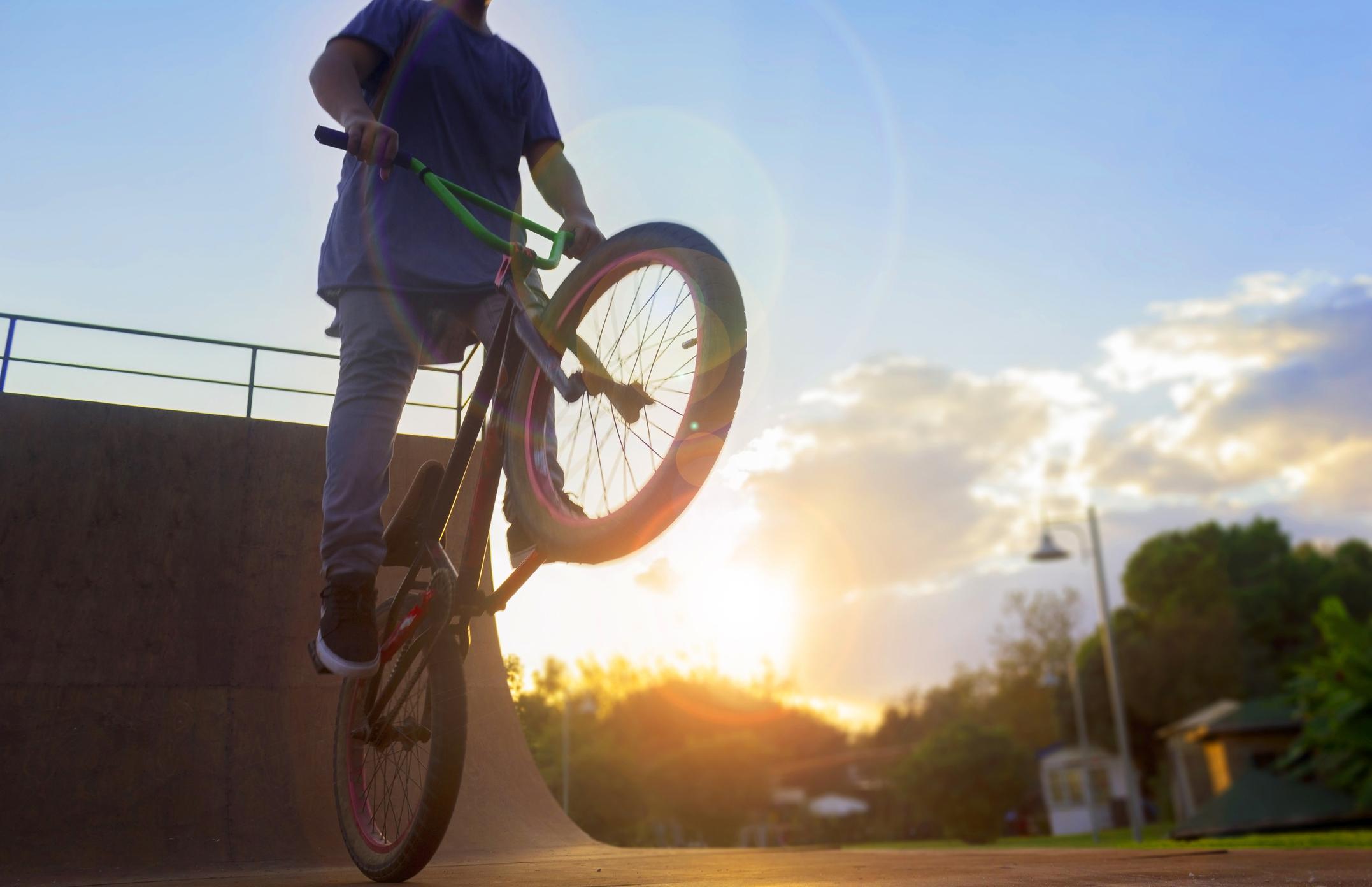 BMX bike rider jumping with bike on bicycle ramp