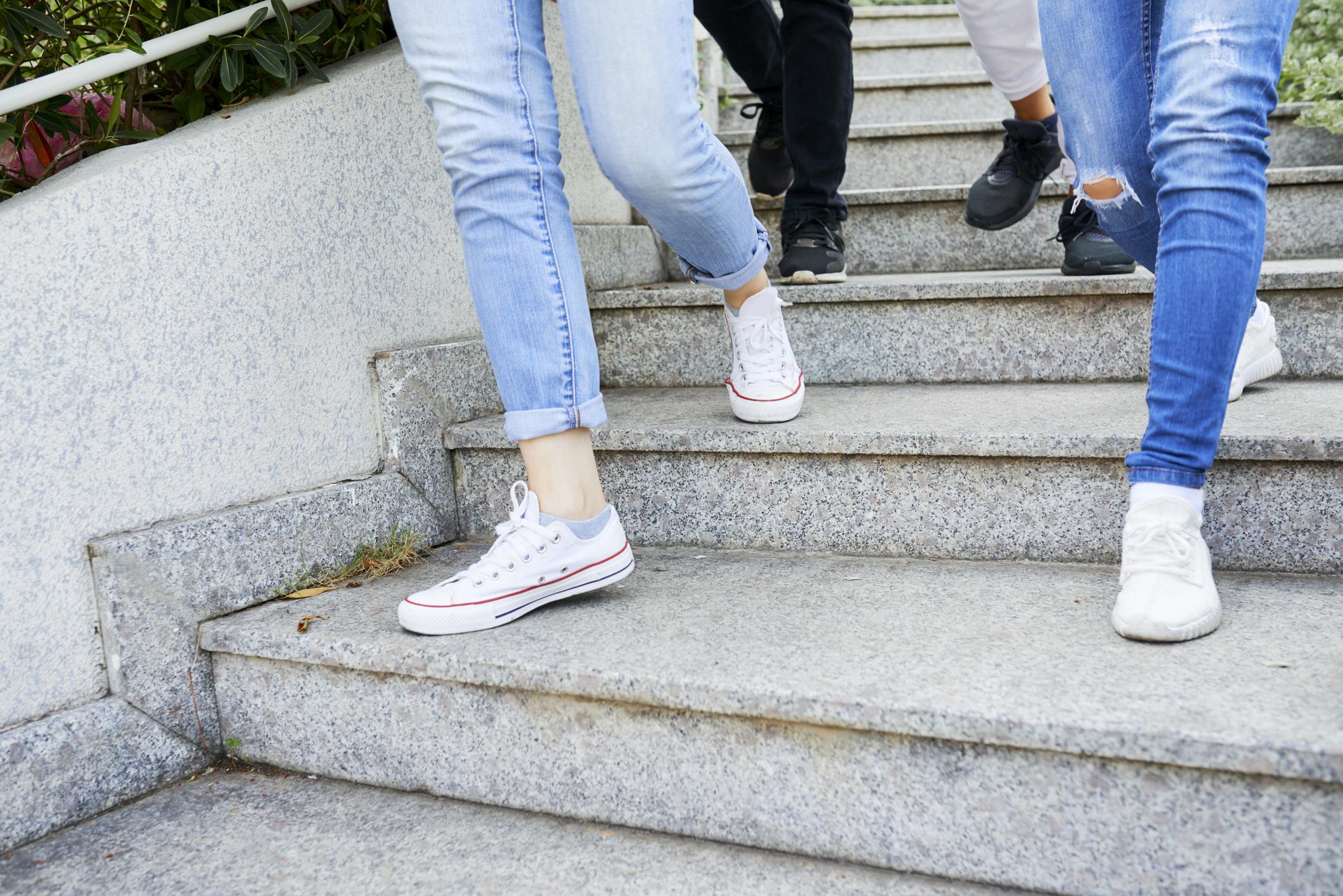 feet of young people walking